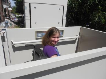 Angelique on her wheelchair lift